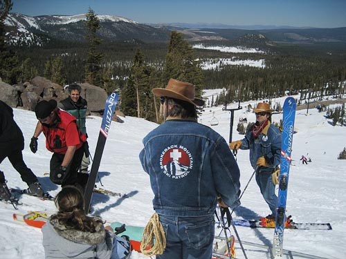 Brokeback Ski Area patrollers assisting injured skier